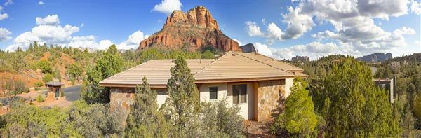 Back of home with red rock view